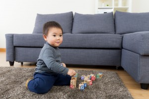 image of boy playing on rug for Sydney residential rug cleaning service from carpet cleaning authority