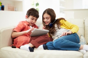 image of kids on sofa for Sydney residential upholstery cleaning service from carpet cleaning authority